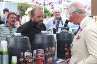 Prince Charles inspecting a local brew